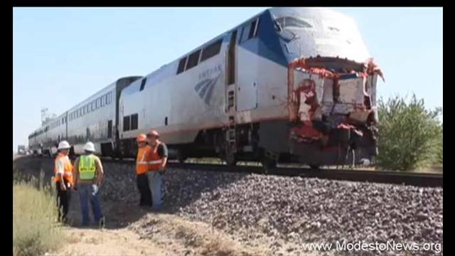 Big Rig Carrying Tomatoes Struck by Amtrak Train | Nelson