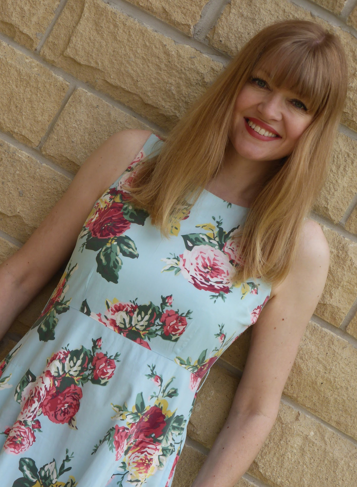 Over 40s blogger What Lizzy Loves wearing multi coloured rose print summer dress