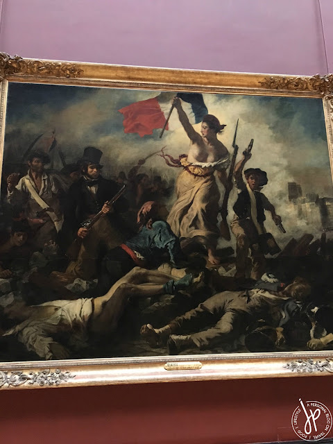 revolution painting, woman holding a flag, dead bodies
