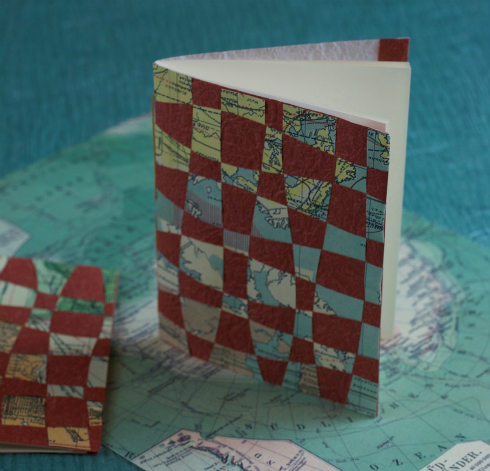 small rectangular handmade notebook with a woven paper cover
