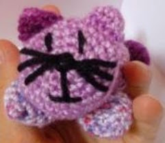 http://www.craftsy.com/pattern/crocheting/other/crochet-cat-pin-cushion/56940