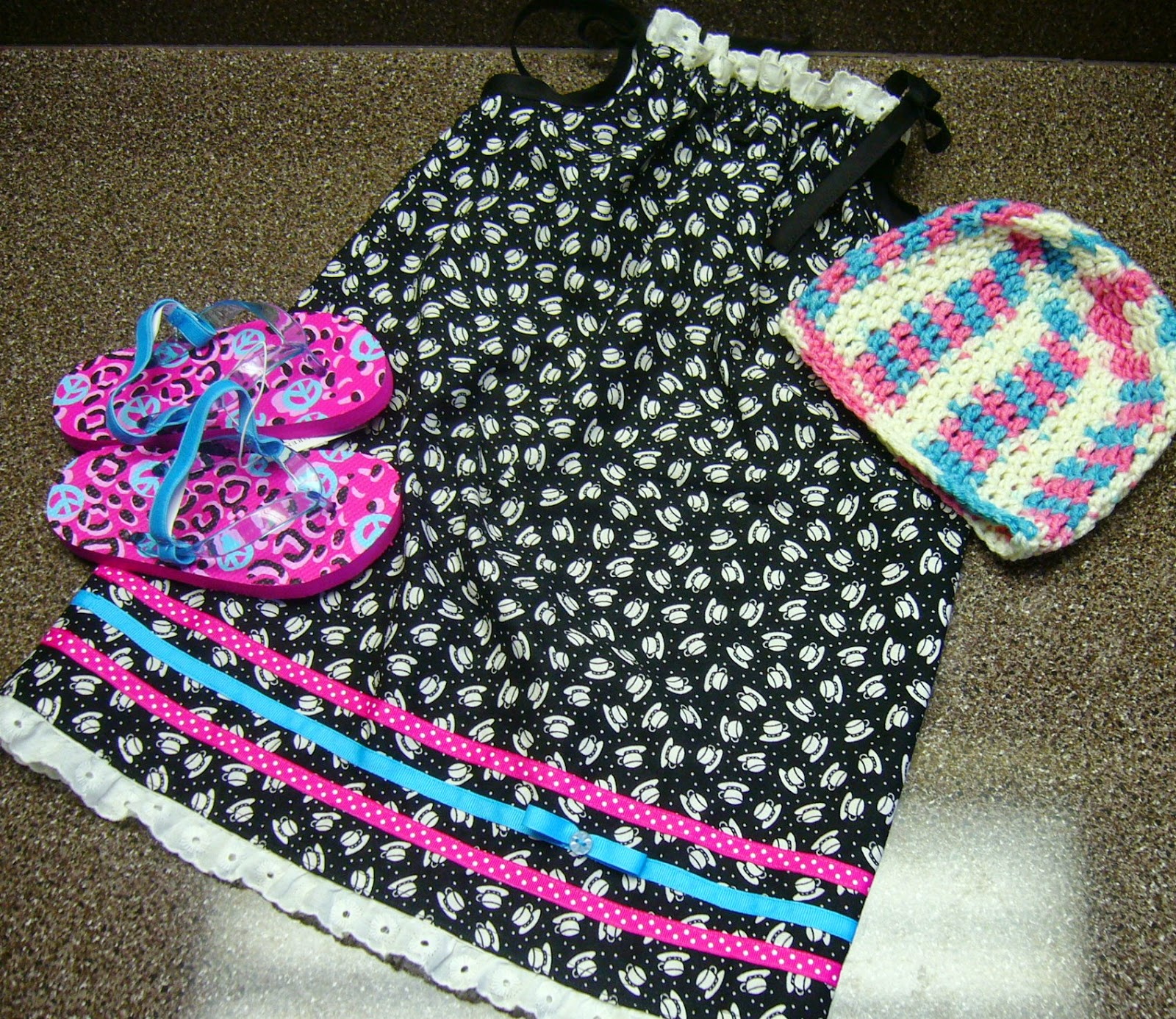 Dress, hat and flip flops for 2 to 4 year old girl Operation Christmas Child shoebox.
