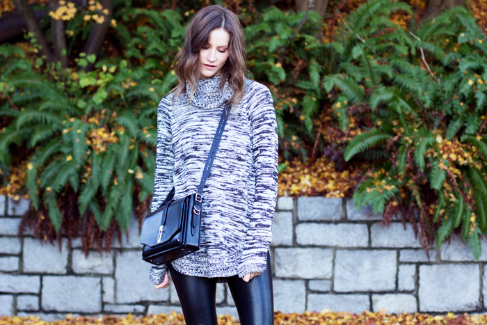 Vancouver Fashion Blogger, Alison Hutchinson, is wearing a Dynamite Sweater, Rag & Bone Bag, and Aritzia Faux Leather Leggings