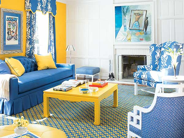 The Living Rooms Royal Blue Upholstery Scheme A Yellow Lacquered Coffee Table And Trim On Curtains Cornice Add Even More Punch To Mix