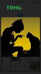 отображение тени женщины с кошкой