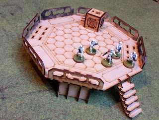 A TTCombat Landing Pad unpainted with Stormtroopers