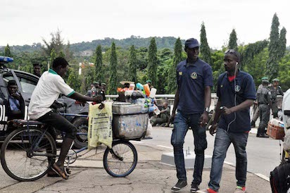 Bribe in the Open: An officers of the Abuja Environmental Protection Board (AEPB) collecting bribe at Villa gate yesterday. Photo by Gbemiga Olamikan