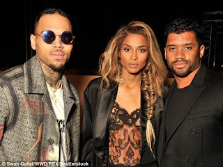 Ciara puts nipple on display in sheer lace vest top in Paris
