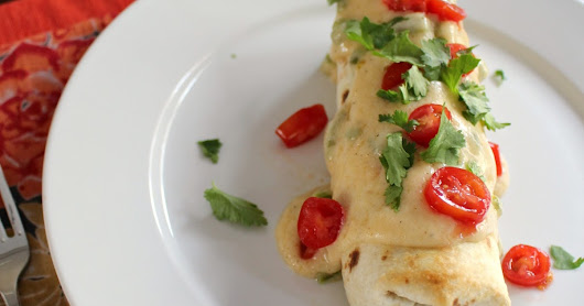 Oven Baked Chicken Burritos Smothered in a Creamy Roasted Jalapeno Sauce