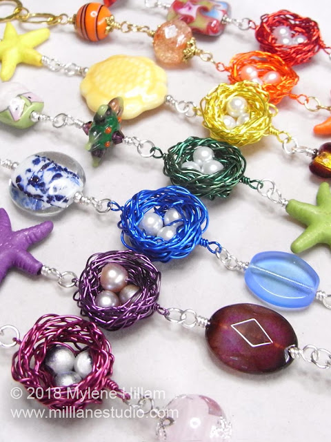 A rainbow of wire bird's nests bracelets with secure wire wrapped loops.
