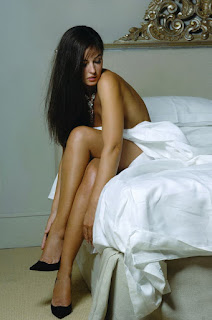 Monica Bellucci Smooth Legs While Sitting On Bed