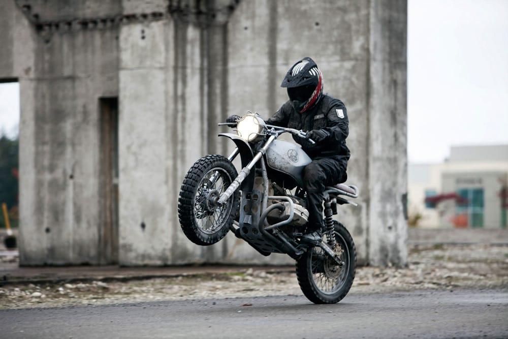 a man riding a custom Ural scrambler