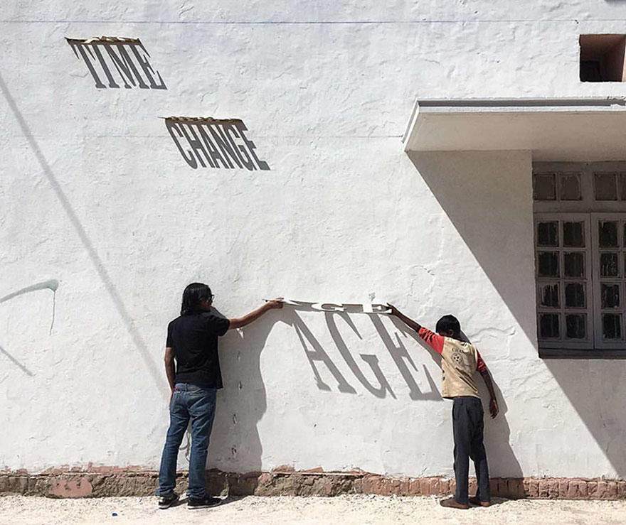Ever Changing Typographic Shadow Graffiti Turns Building Into Masterpieces