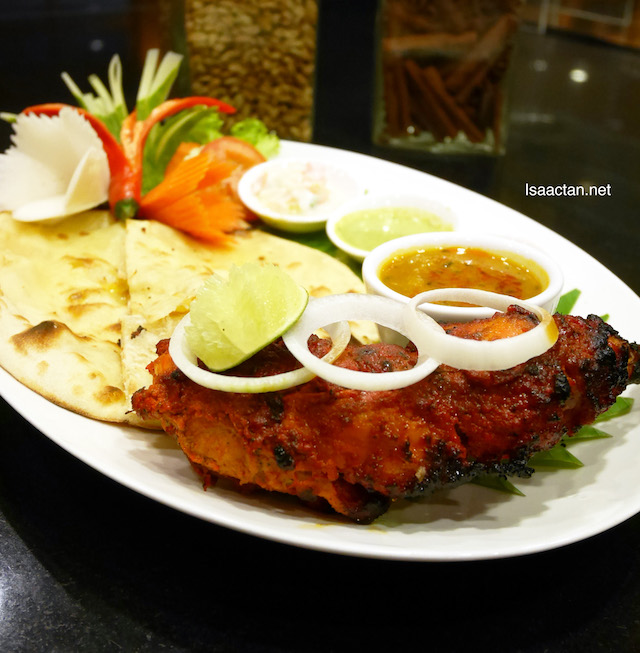 Tender Tandoori Chicken served with fresh Naan Bread and condiments