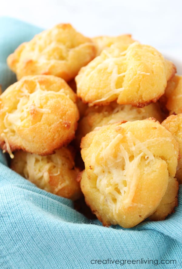 This is an easy keto garlic bread recipe that is low carb and gluten free. Instead of cauliflower, it uses coconut flour and almond flour together with cheese and eggs in a fathead style bread that doesn't use cream cheese. It's quick to make and is the best keto roll recipe out there! Tie them in knots or roll them into rolls. #creativegreenkitchen #creativegreenliving #keto #glutenfree #ketobread #fathead #ketorolls #lowcarb #lowcarbbreadrecipe #ketogarlicbread