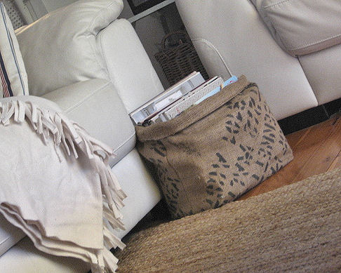 This burlap basket is a perfect place to store magazines, books, or newspapers next to the couch
