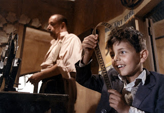 Philippe Noiret and Salvatore Cascio in one of the most famous screenshots from Nuovo Cinema Paradiso