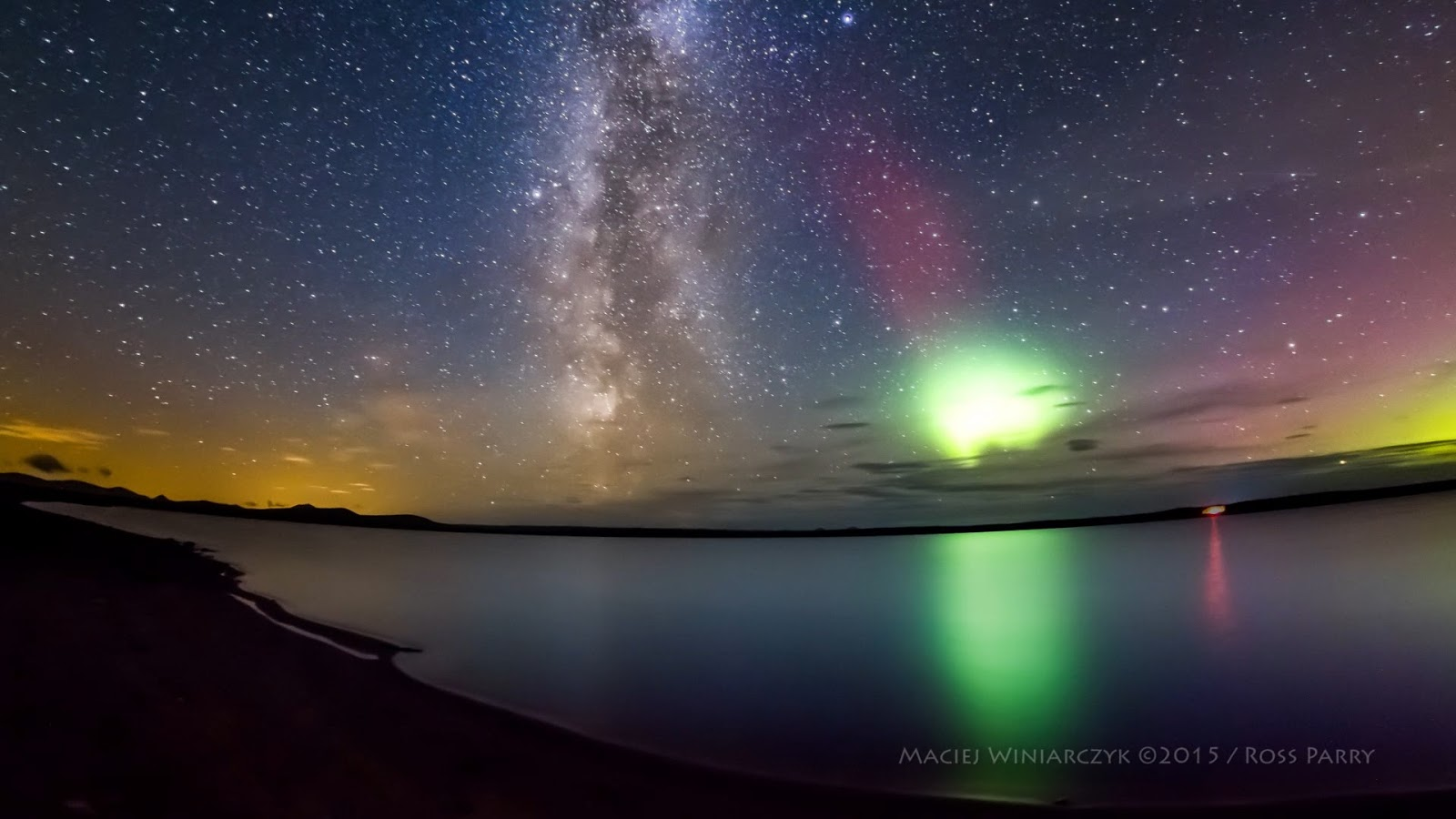 Watch The Milky Way Get Photobombed By The Northern Lights.