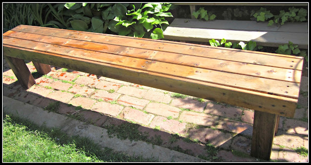 Garden bench with stain