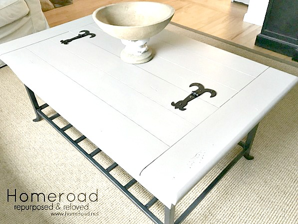 Painted coffee table in neutral color with iron details