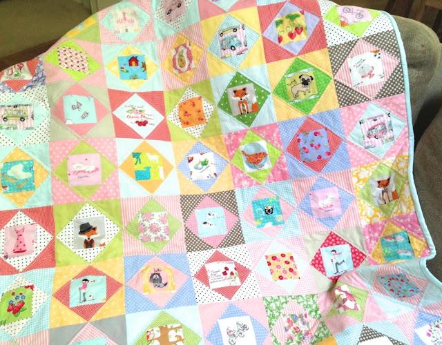 Pastel, scrappy economy block quilt