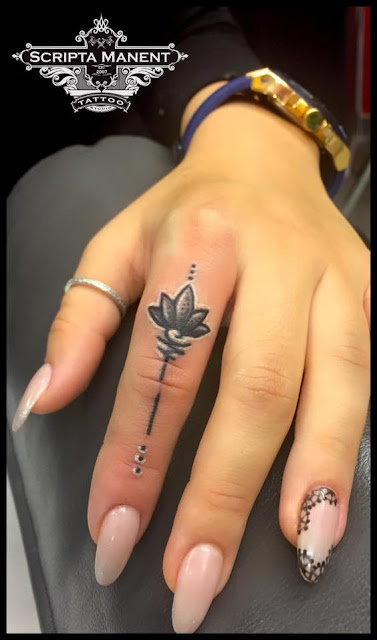 Awesome Finger Lotus Flower Tattoo For Girls