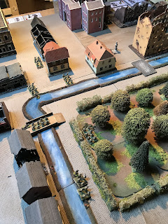 Canadian infantry move through Mons