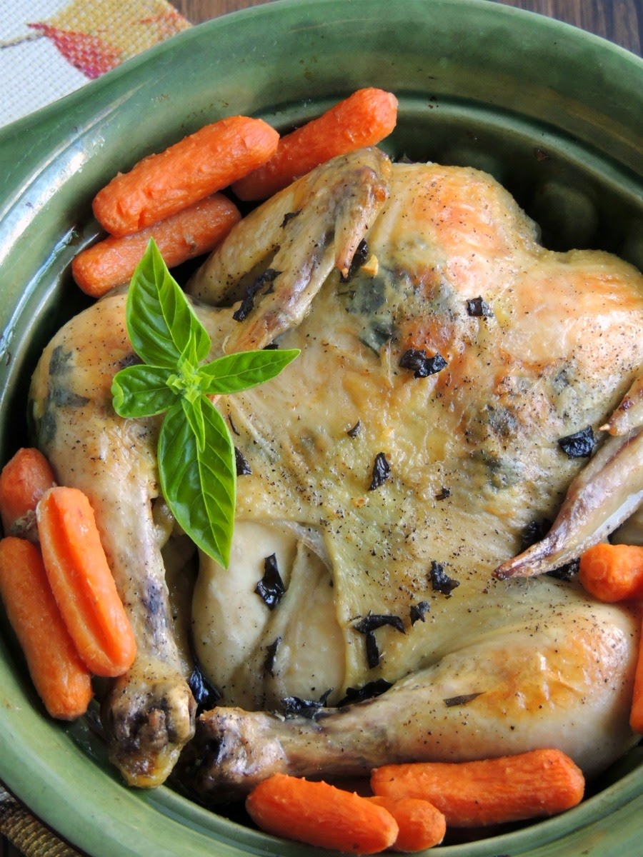 Forget that store bought rotisserie chicken! This flavorful & juicy Basil & Garlic Slow Cooker Roasted Chicken slow cooks in your crock pot all day.