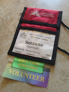 CSLA Conference name badge with First Time Attendee and Volunteer ribbons