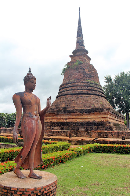 a statue in Ancient City of Sukhothai