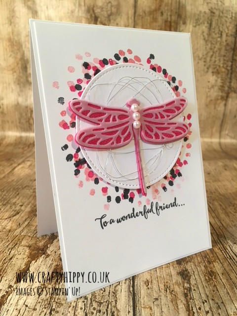This image shows a hand stamped card featuring a dragonfly stamped using the Dragonfly Dreams stamp set and Melon Mambo ink by Stampin' Up!