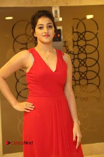 Actress Mouryani Stills in Red Dress at Intlo Deyyam Nakem Bhayam Trailer Launch 0017