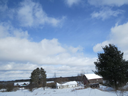 blue sky in winter above old barns