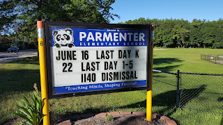 Parmenter sign showing last day for K on June 16, all other classes June 22