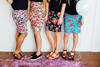 4-woman-in-floral-print-skirt-and-black-shirt
