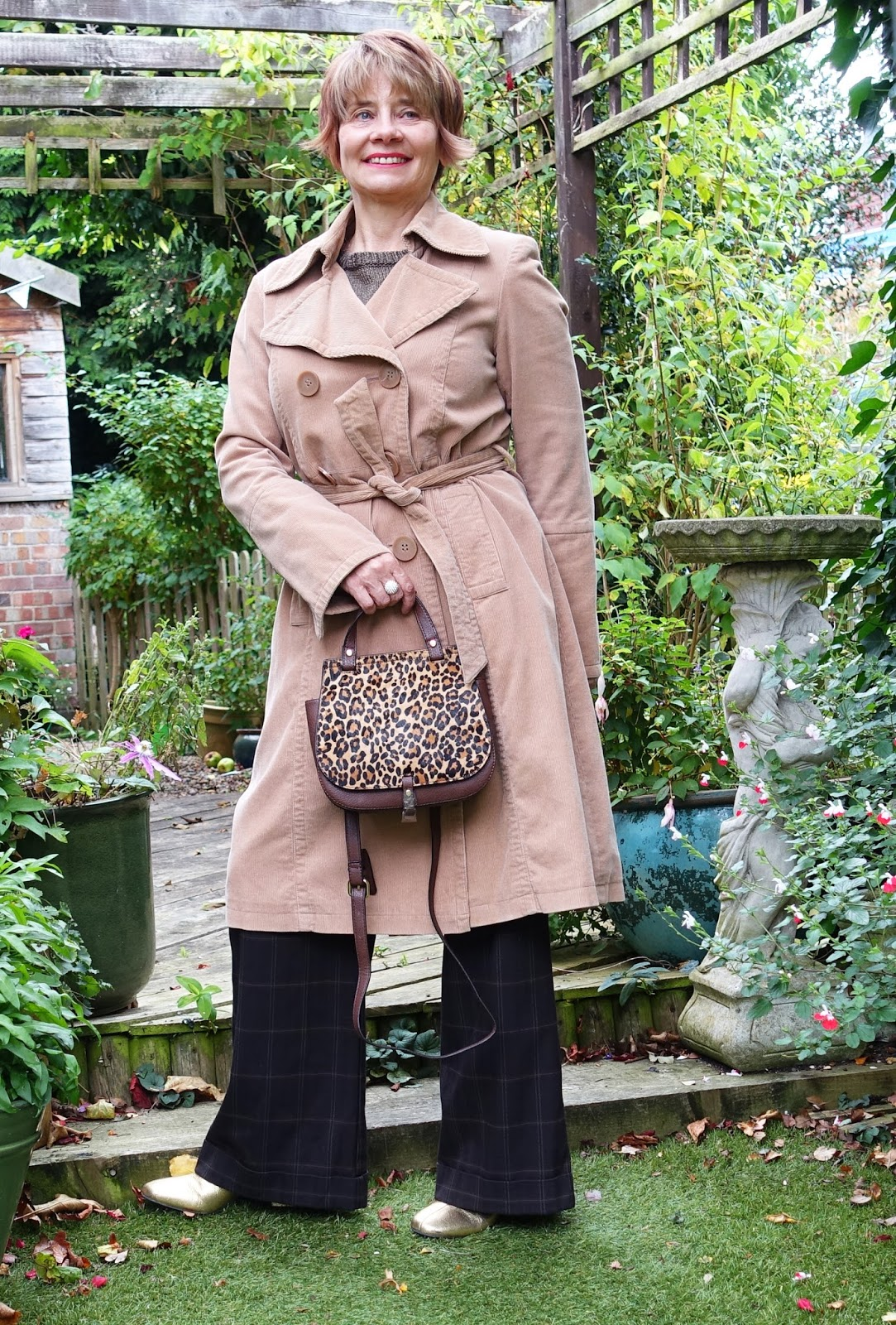 Image showing woman over 40 in camel corduroy coat brown Oxford bag trousers and leopard print bag for No-Spend-October-2017