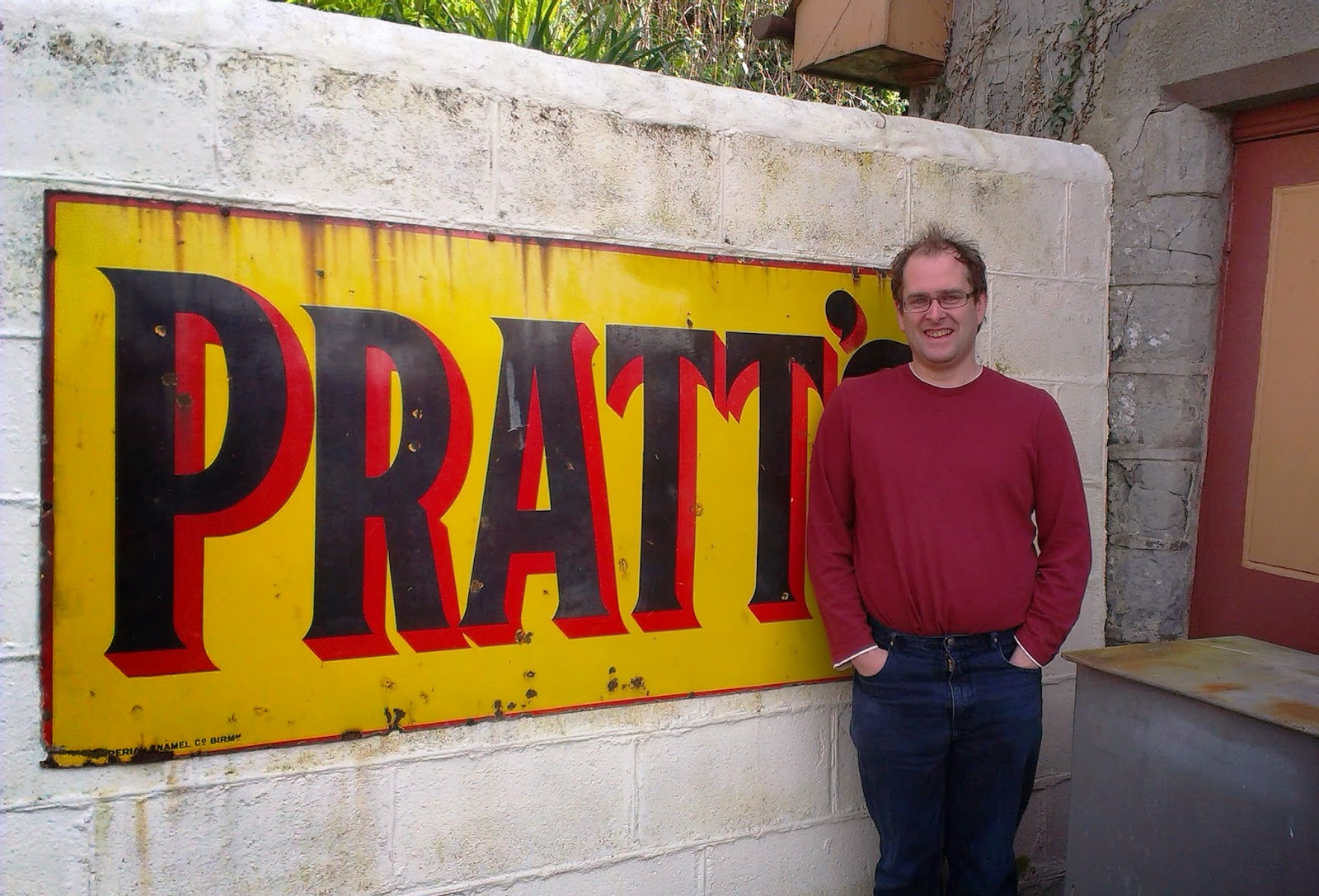 Andrew in front of a vintage Pratt's sign