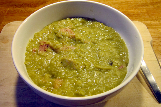 A bowl of pea and ham soup