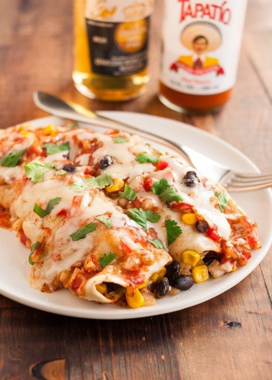 Slow Cooker Vegetarian Black Bean Enchiladas Recipe from The Kitchn found on SlowCookerFromScratch.com