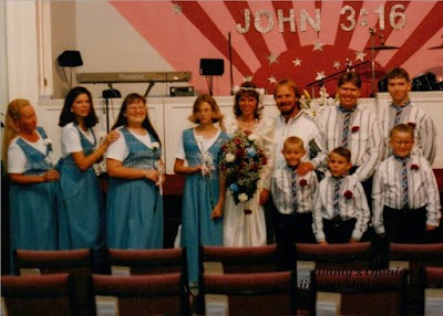 Wedding party standing inside of church on July 24th 1997