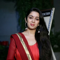 Rosy fair Charmi kaur photos in red salwar kameez at country club asia's biggest new year bash 2014 press meet