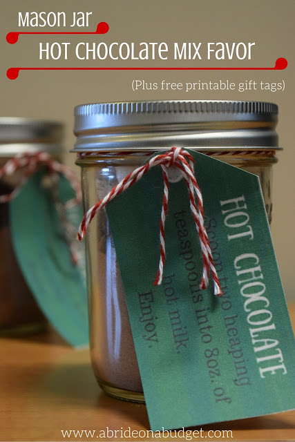Hot chocolate is a PERFECT winter wedding favor. Find out how to make these Mason Jar Hot Chocolate Mix Favors, and get a free printable gift tag, from www.abrideonabudget.com.