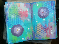 page showing artwork in fabric art journal