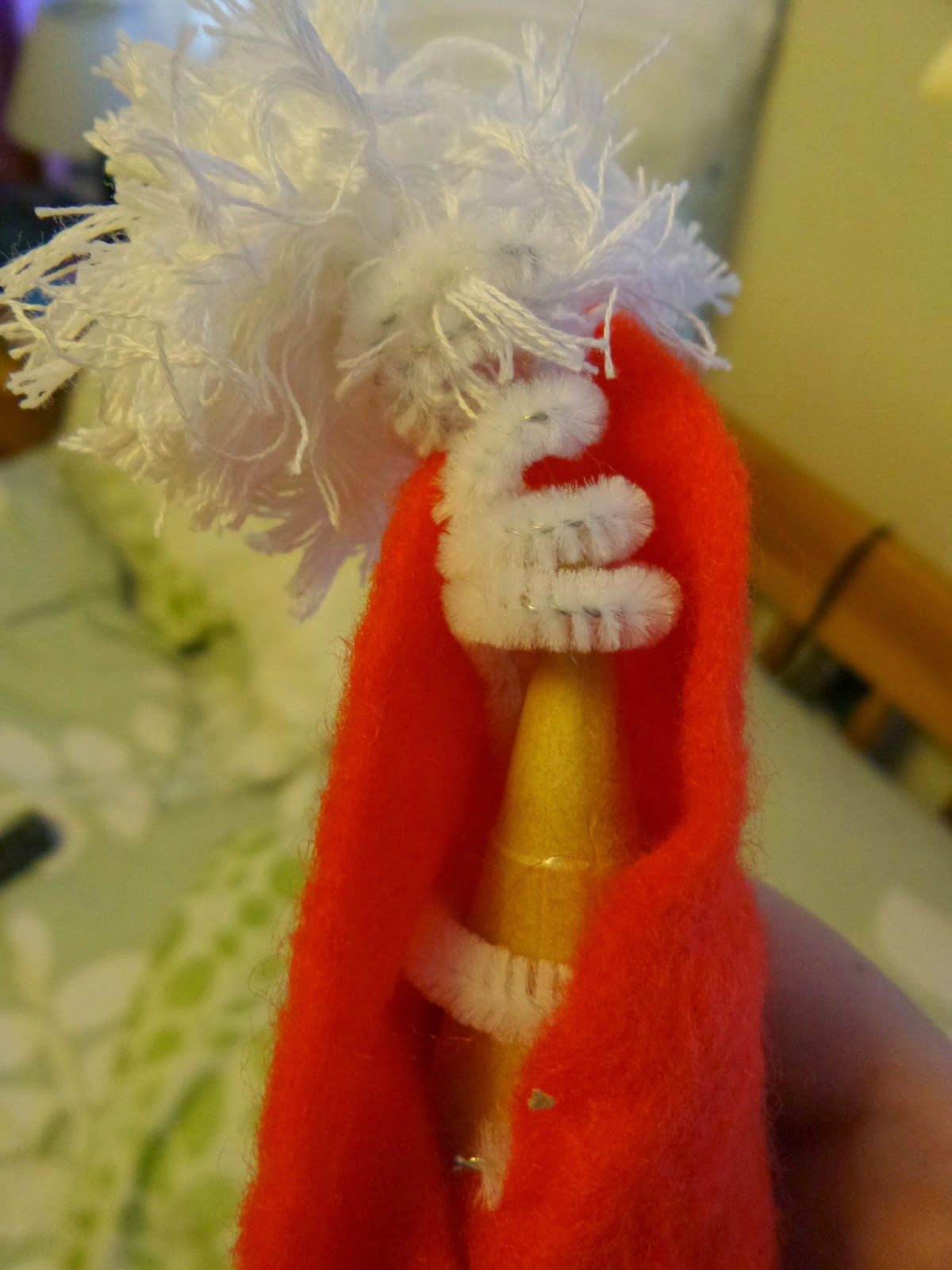 Santa Hat Pompom on a pipe cleaner