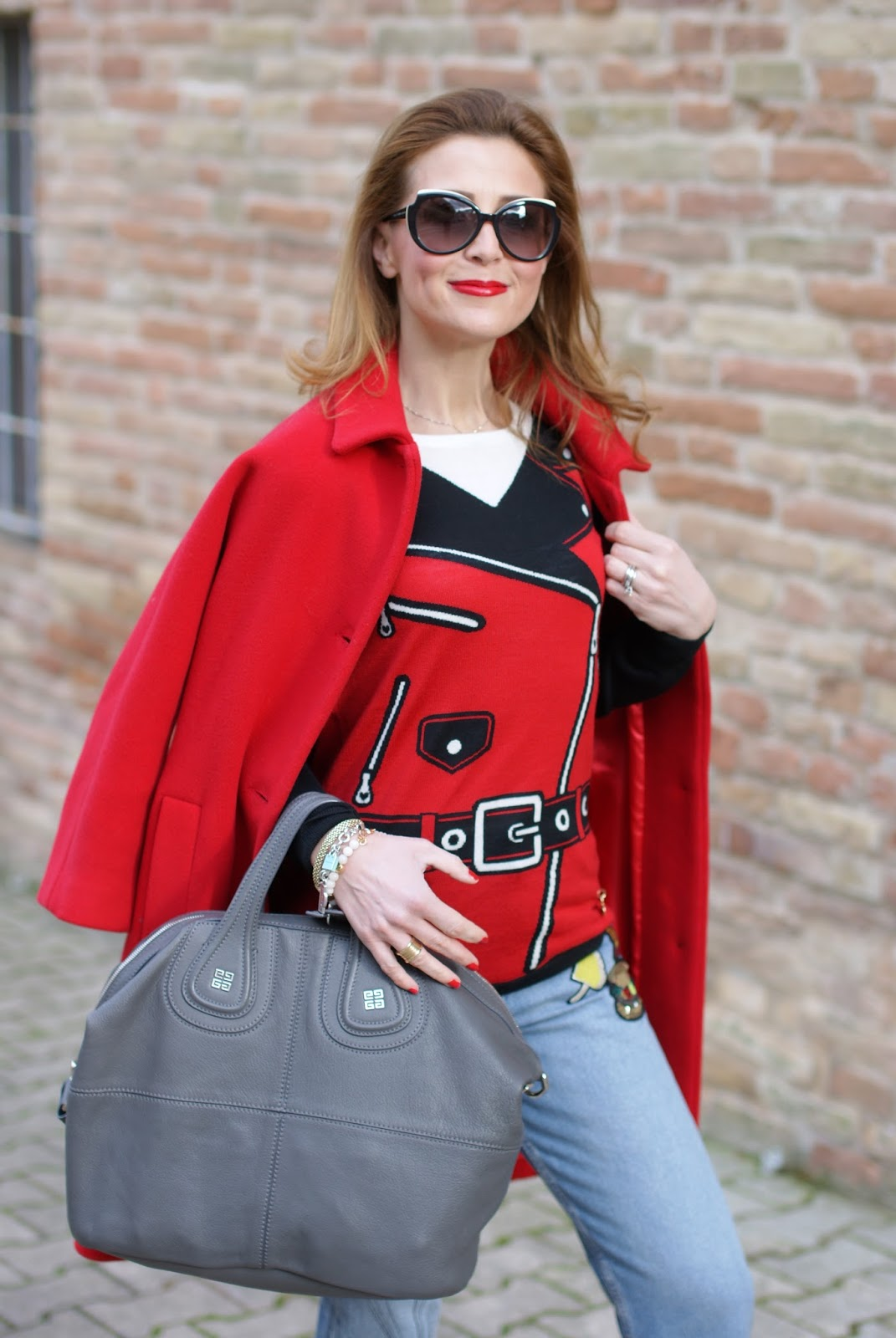 Casual transitional spring outfit with moschino sweater, red coat and grey Nightingale bag on Fashion and Cookies fashion blog, fashion blogger style