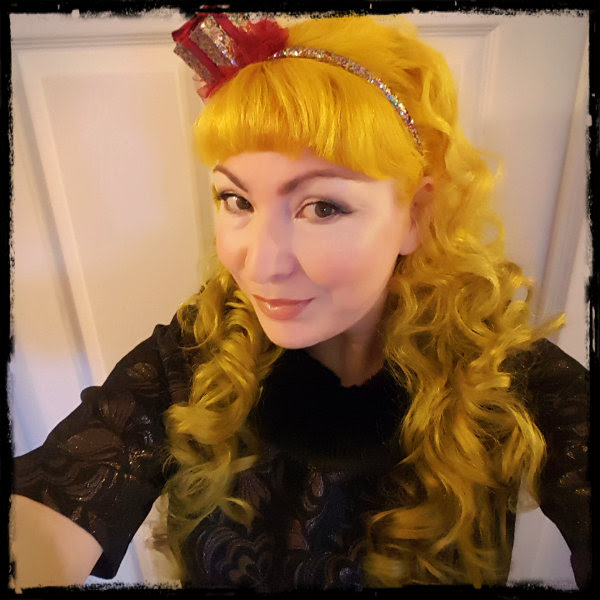 face with festive makeup Fudge Paintbox Gold Coast yellow hair and glitter novelty hairband