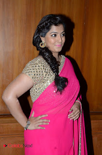 Actress Varalakshmi Pictures in Pink Saree at Madha Gaja Raja Audio Launch  0007.JPG