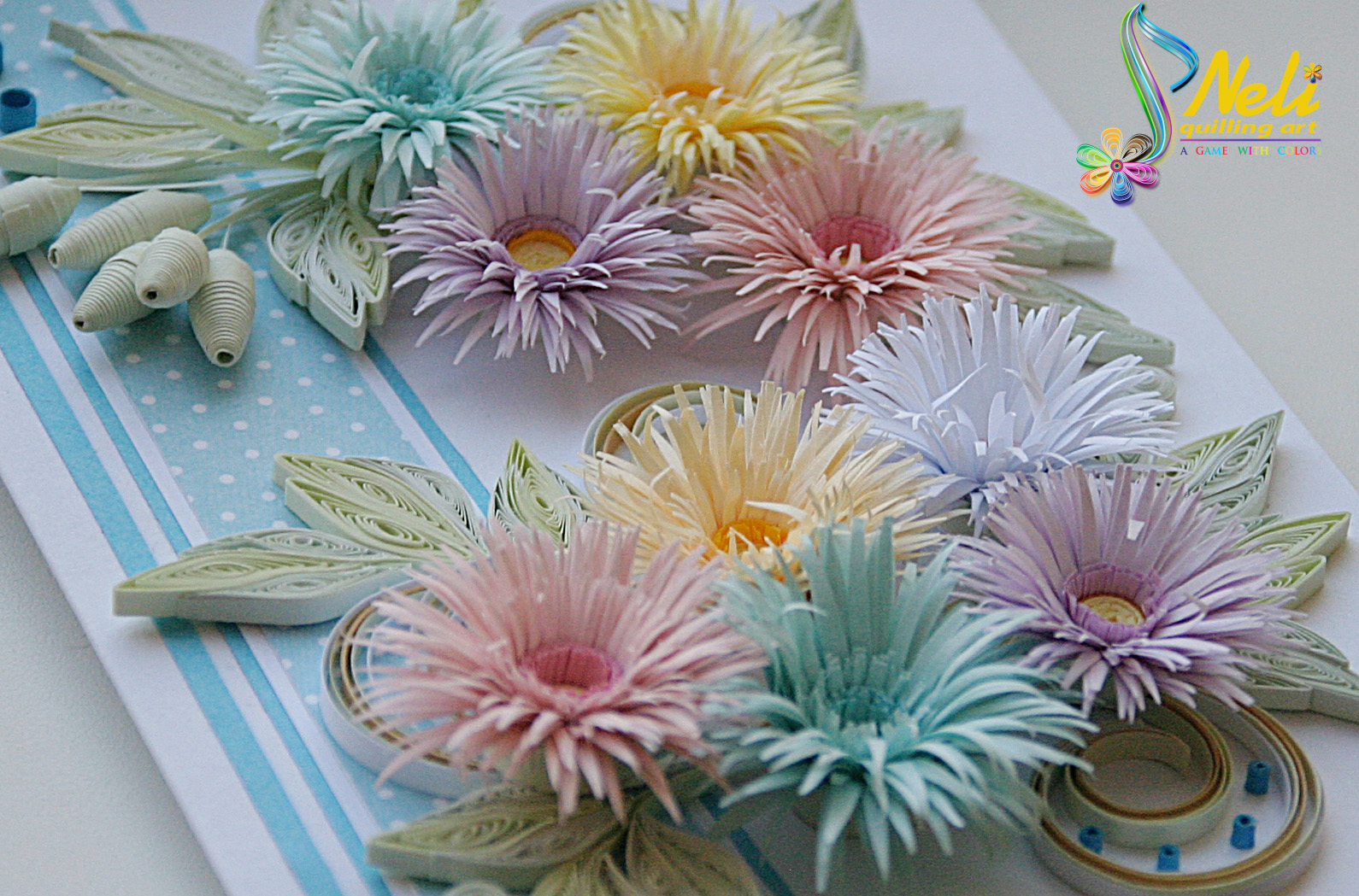 quilling projects Quilling project requirements ( usual quilling tools, scissors, glue, seed beads for 2 flower centres,  photos of paper quilling projects.