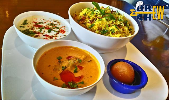 Big Pitcher Bangalore, murgh biryani with salon, raita, laccha onion and Jamoon