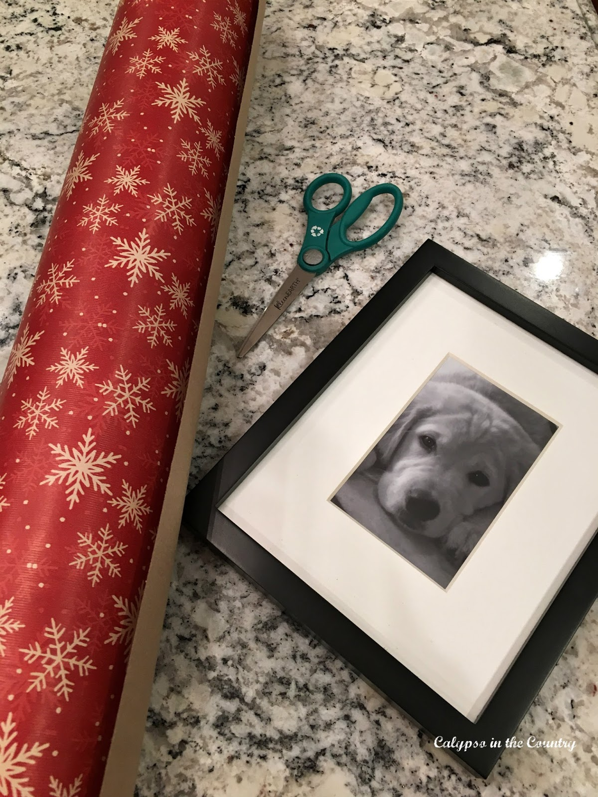 Wrapping paper and black picture frame